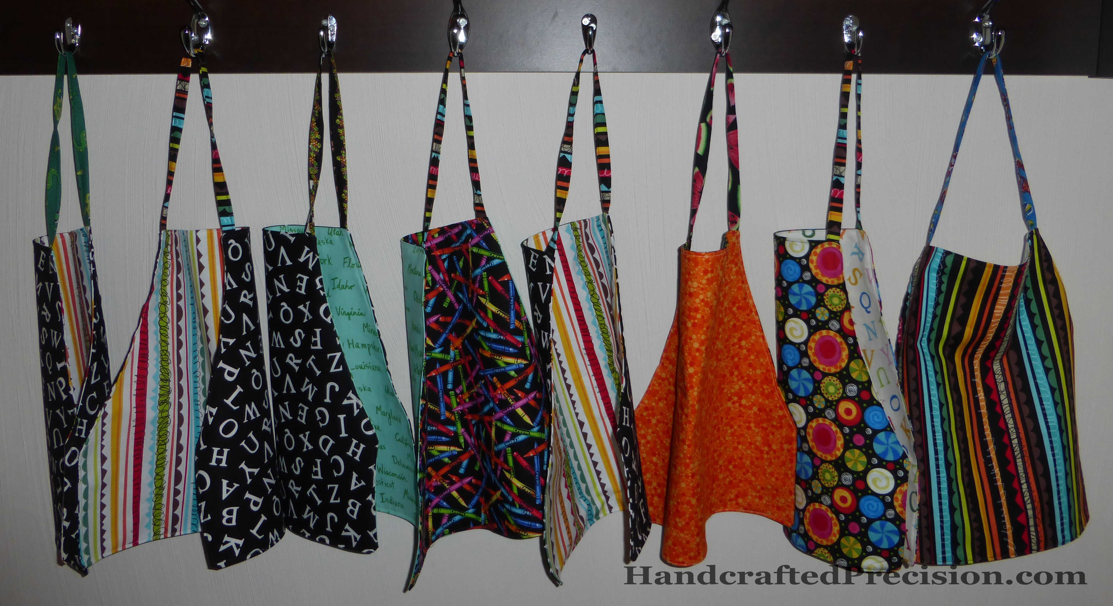 Finished Toddler Aprons Hanging HP